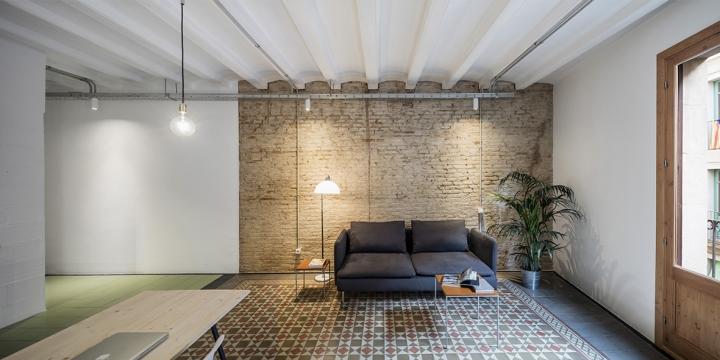 RÄS studio keeps beautiful old floor tiles in La Carme apartmentremodel