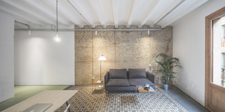 RÄS studio keeps beautiful old floor tiles in La Carme apartment remodel