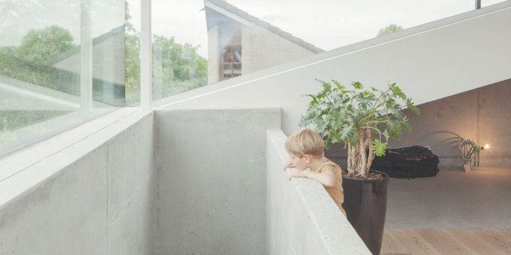 i.s.m.architecten designed amazingly warm and cozy concrete house
