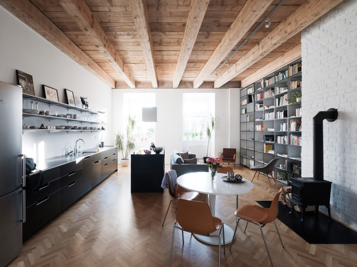 JRKVC designed clean and functional apartment using full height book shelf as a space divider: JRKVC - TRN Apartment Refurbishment