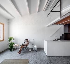 RÄS studio used rediscovered attic space for a new mezzanine floor in La Domenique apartment remodel: RÄS - La Domenique