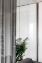 Apartment remodel in Zagreb | built in closet | curtains | plants | glass wall