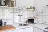 Apartment for daily rent | interior design | kitchen | light kitchen | white tiles | black grouts | neutral palette