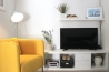 Apartment for daily rent   interior design   living and bedroom   yellow ikea armchair   neutral palette